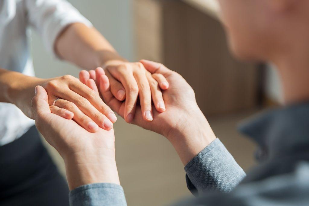 young-man-holding-hands-girlfriend.jpg