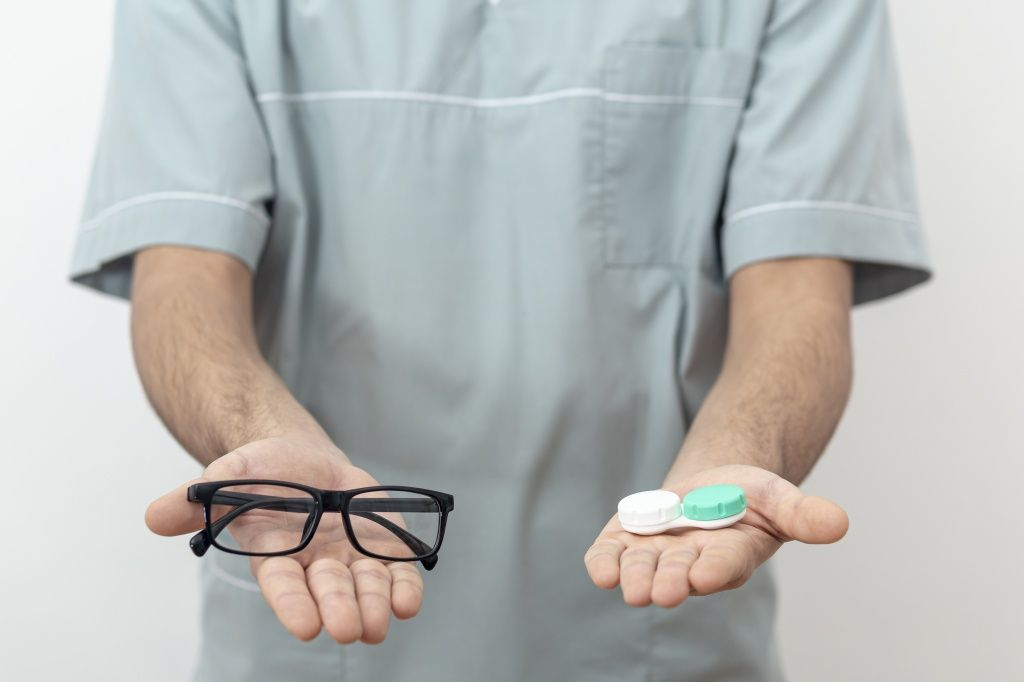 front-view-of-eye-specialist-holding-glasses-and-contact-lenses.jpg